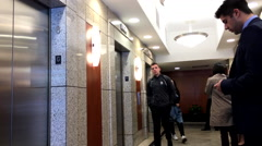 People leaving office elevator in downtown Vancouver - stock footage