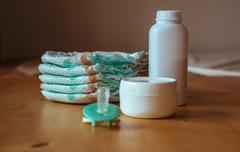 Set of accessories for baby disposable diapers, things for child care Stock Photos