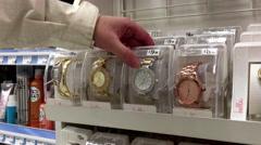 People taking Bella watch inside Shoppers drug mart store Stock Footage