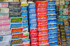 FLORENCE, ITALY - JUNE 12, 2015: Florence guide maps and turistic guides in all - stock photo