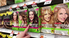 People taking garnier nourishing colour cream inside Shoppers drug mart store Stock Footage