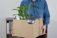 Man carrying box beacause he is layoff Stock Photos
