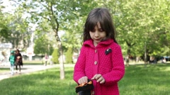 Little Girl Putting Protective Gloves on Fast Forward Stock Footage
