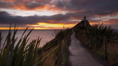 Colorful Sunrise Timelapse at Nugget Point Lighthouse. Stock Footage
