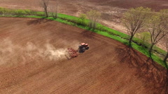 Springtime agricultural activity, tractor cultivating field - stock footage