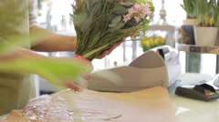 Florist with flowers and customer at flower shop Stock Footage