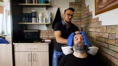 Eccentric stylist washes head respectable men. Businessman visits to his barber Stock Footage