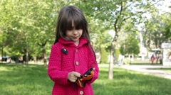 Little Girl Putting Protective Gloves On Slowly Stock Footage