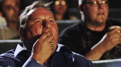 Man Eating Popcorn Stock Footage