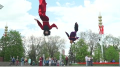 Slow motion video of street acrobats with fly jumpers in Moscow.  Stock Footage