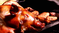 Suckling Pig on barbecue smoker grill - stock footage