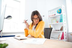 Businesswoman analysing document Stock Photos