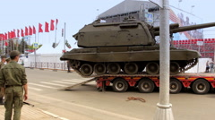 Tank drives off the trailer Stock Footage