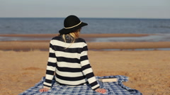 Girl reading a book lying on the beach Stock Footage