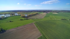 Aerial view of farm fields in spring Stock Footage