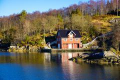 Fjord side cabins near Bergen, Hordaland, Norway, Scandinavia, Europe - stock photo
