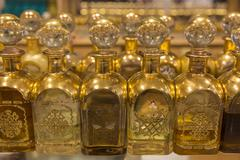 Local frankincense perfumes in ornate gold and glass bottles, Al-Husn Souq, Stock Photos