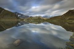 The snowy peaks are reflected in Fenetre Lakes at dawn, Ferret Valley, Saint Stock Photos