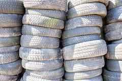 Pile of used old car tires. - stock photo