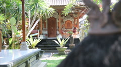 Typical Balinese house with a carved chair on the porch. Ubud, Bali. Stock Footage