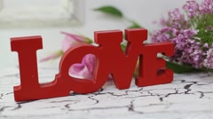 """Etters from wooden """"LOVE"""" on the vintage red stand Stock Footage"""