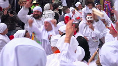 Masked people dancing in a square to celebrate the Carnival in Italy Stock Footage