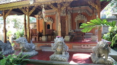Typical Balinese house with a carved chair on the porch. Inner court. Stock Footage