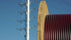 Electrical Pole to Wire Roll Pull Focus Stock Footage