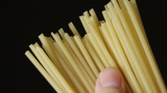 Human hand touches a pile of a spaghetti Stock Footage
