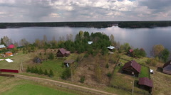 View at the small Russian village on the lake shore at the spring season, Russia Stock Footage