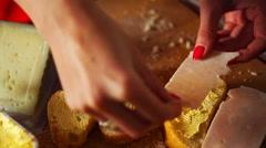 Woman preparing sandwich, putting ham on bread in kitchen Stock Footage