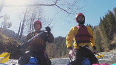 Two sportsmenon the rafting competiton Stock Footage