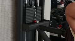 Training apparatus in gym hall. Black weight for exercise equipment in gym hall. - stock footage