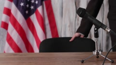 US flag, man and microphone. Stock Footage