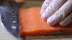 Sushi chef slicing fresh salman steak in studio Stock Footage