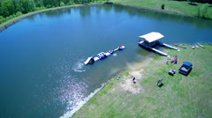 High angle kids playing in lake at summer camp Stock Footage