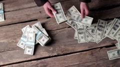 Male hands counting american dollars. - stock footage
