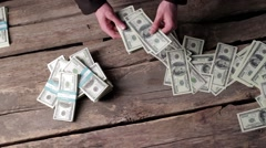 Male hands rapidly counting dollars. Stock Footage