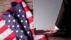 Suitcase, money and US flag. Stock Footage