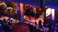 Aerial - thai style outdoor bar live music party Stock Footage