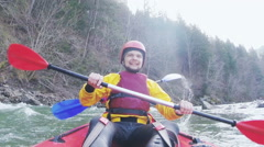 A canoe maneuvering at the river waves with happy sportsmen Stock Footage