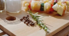 Four chicken and vegetable kabobs on cutting board Stock Footage