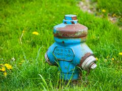 Blue fire hydrant Stock Photos