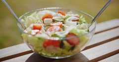 Bowl of fresh mixed green salad Stock Footage