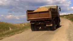 the truck rides on the road ltnim sunny day - stock footage