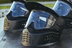 Paintball extreme sport protective equipment masks Stock Photos