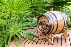 Small barrel for alcoholic drinks. Wooden barrel. Mini barrel. - stock photo