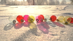 Transparent Christmas balls on snow drift slowmotion Stock Footage