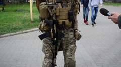 The armed soldier at an exhibition. Stock Footage