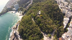 Aerial of beautiful beach and hill in Arpoador Stock Footage